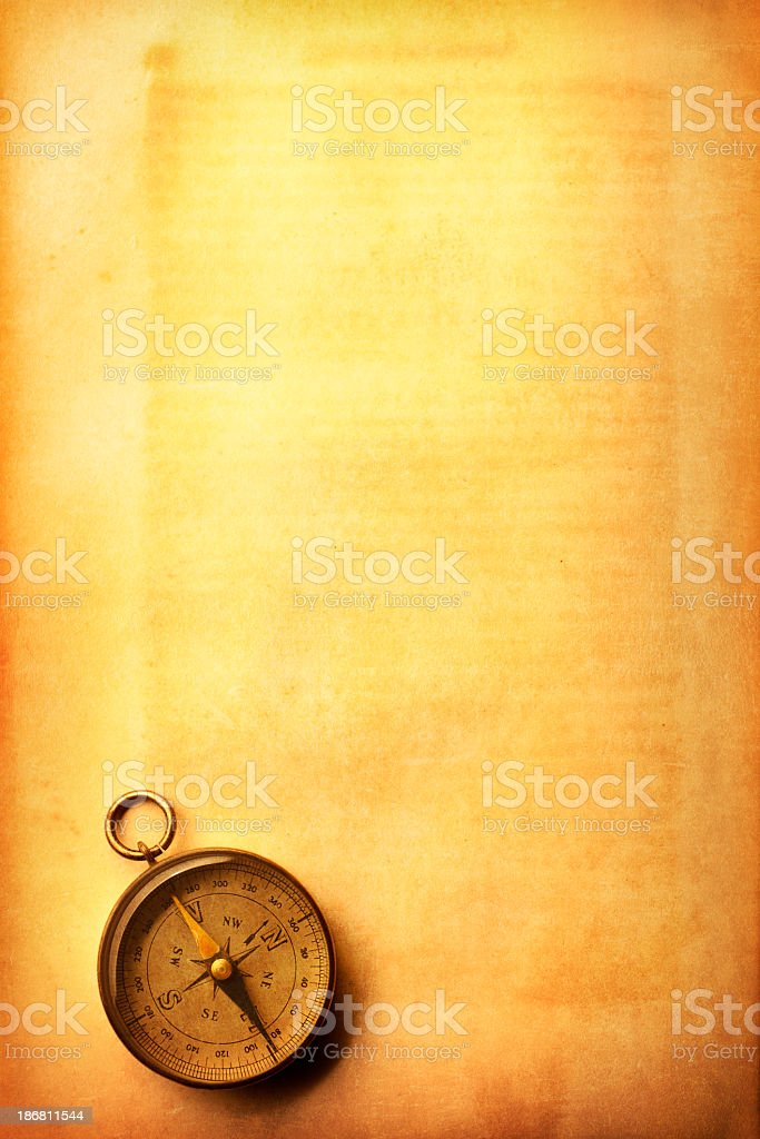 Compass On A Golden Textured Surface royalty-free stock photo