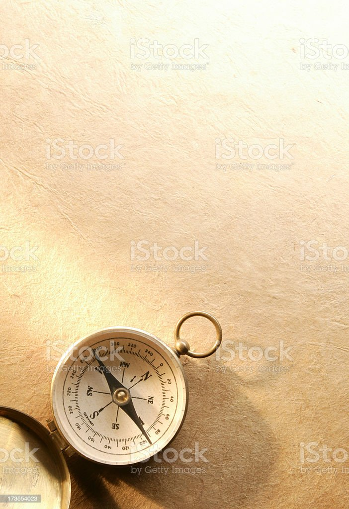 Compass On A Warmly Lit Textured Background royalty-free stock photo