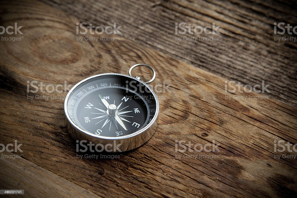 Compass on a wooden background stock photo