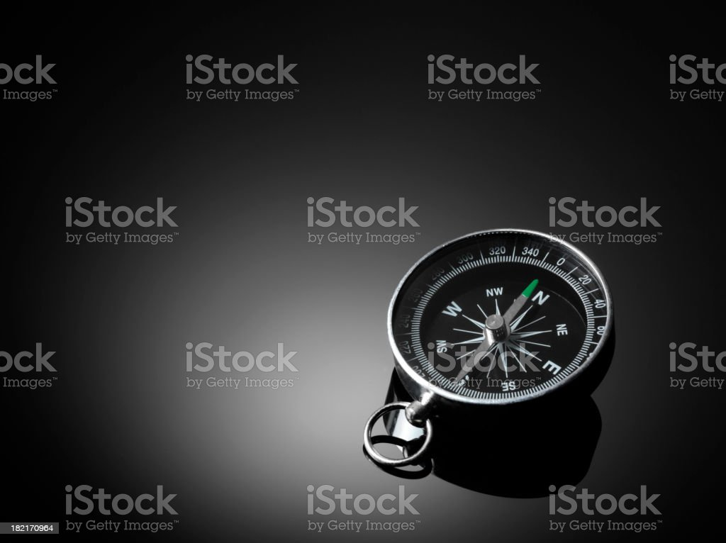 Compass on black background royalty-free stock photo