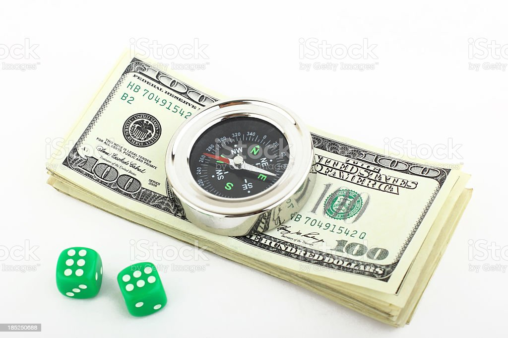 Compass on dollars and dices royalty-free stock photo