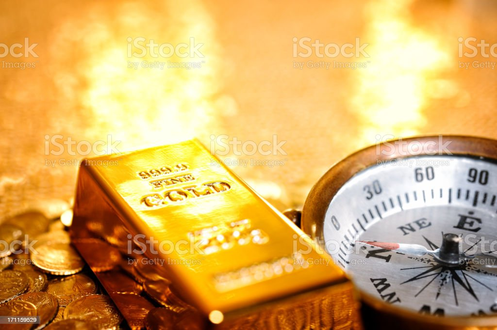Compass on gold assets royalty-free stock photo