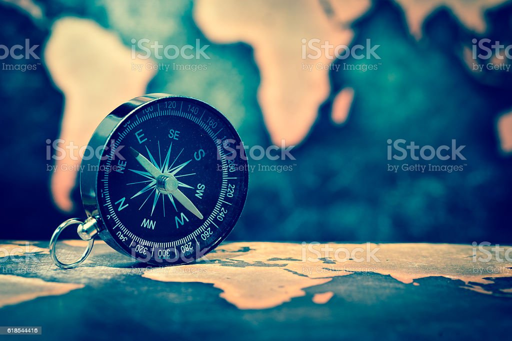 Compass on grunge world map stock photo