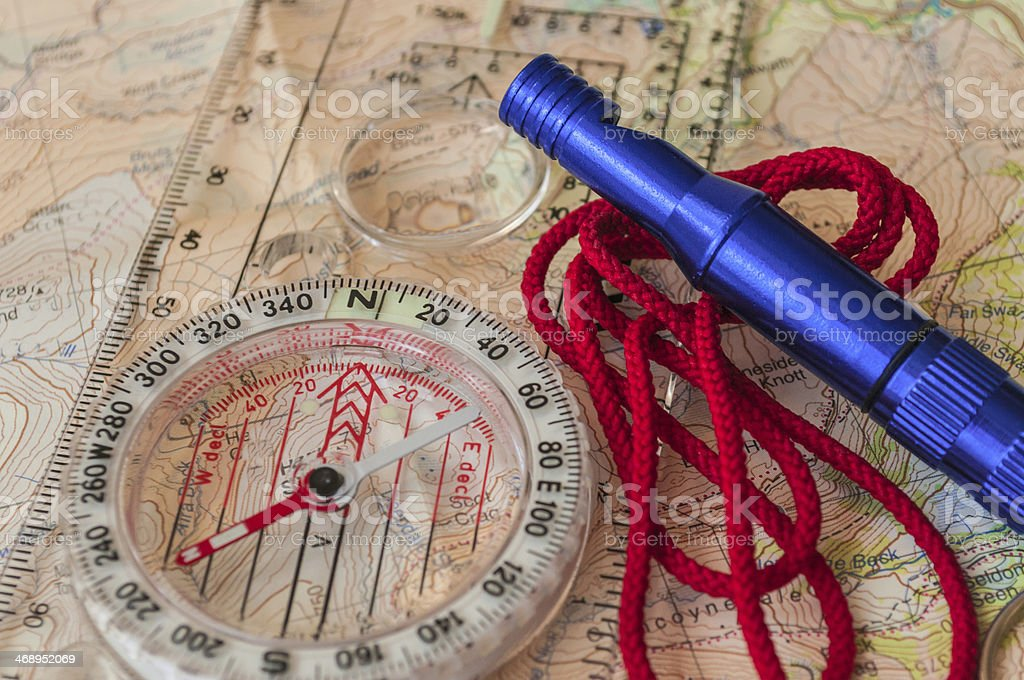 Compass on Map and Rescue Whistle royalty-free stock photo