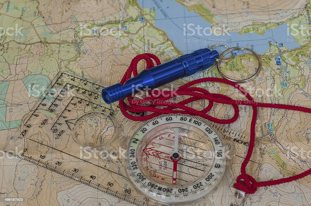 Compass on Map and Rescue Whistle stock photo
