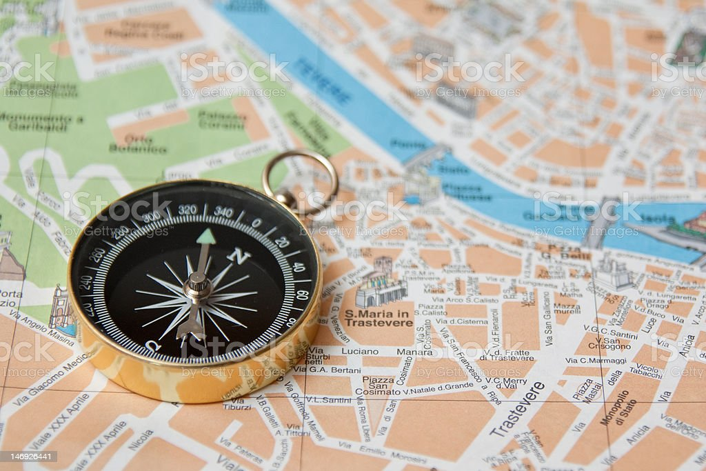 Compass on map of Italian Rome royalty-free stock photo