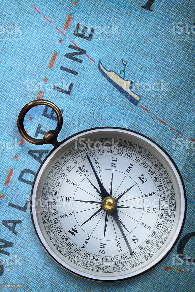Compass on map showing international dateline stock photo