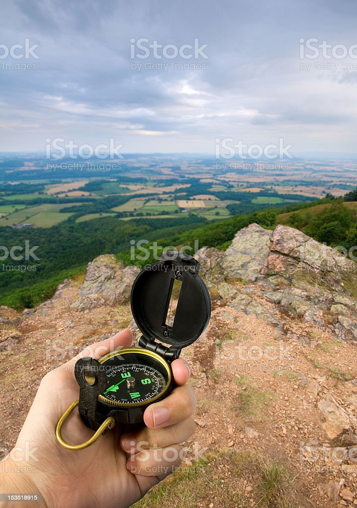 compass on mountain top royalty-free stock photo