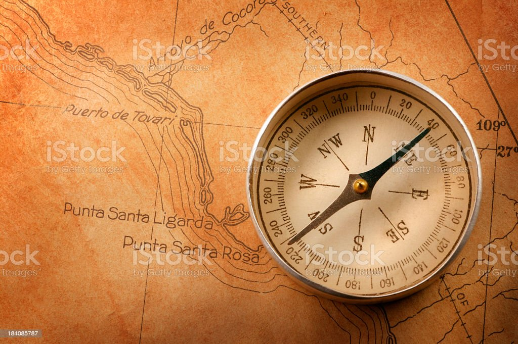 Compass on Old Antique Rusty Colored Map royalty-free stock photo