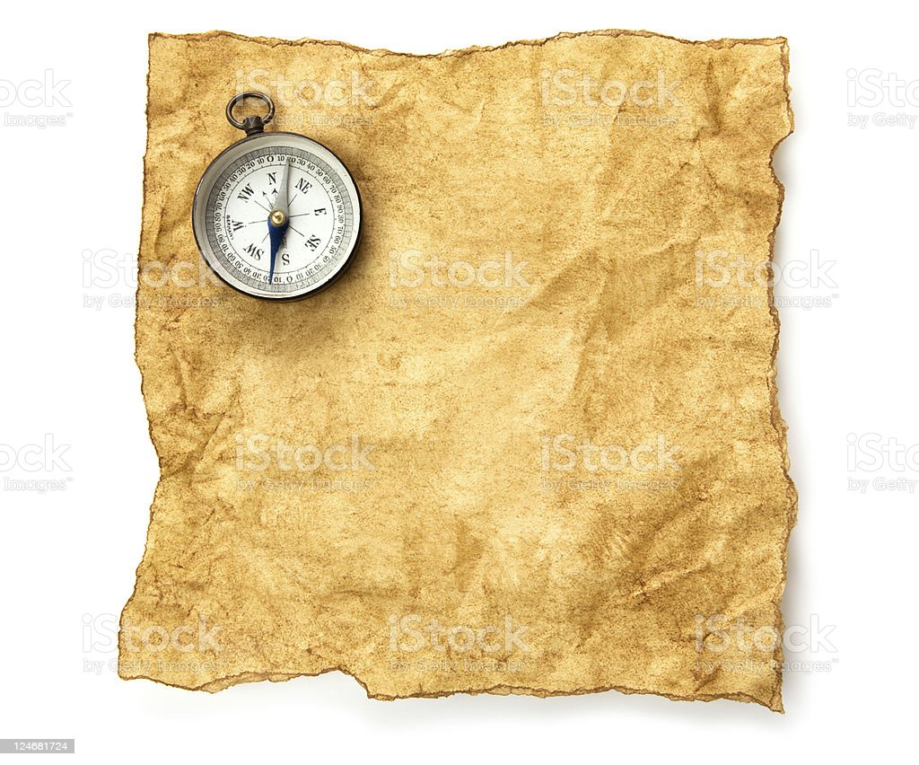 Compass on old paper background royalty-free stock photo