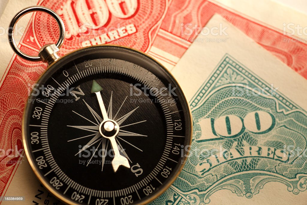 Compass On Stock Old Certificates royalty-free stock photo