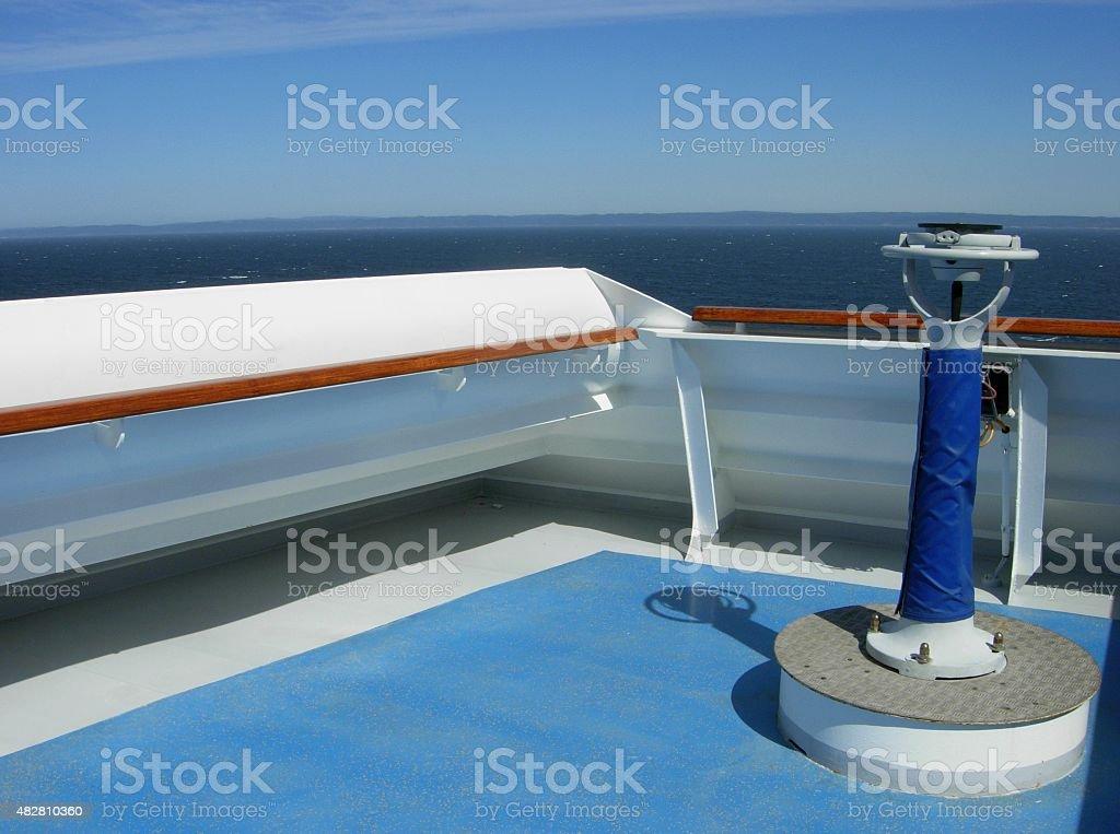 Compass on the bridge of a cruise ship stock photo