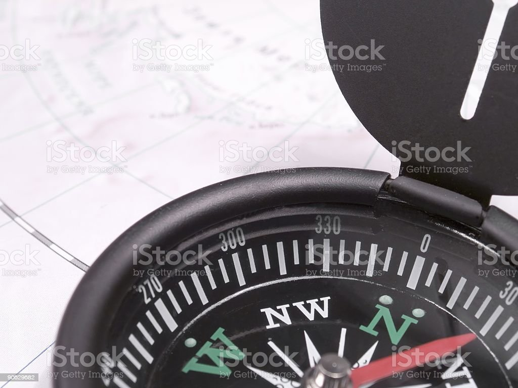 Compass on the map royalty-free stock photo