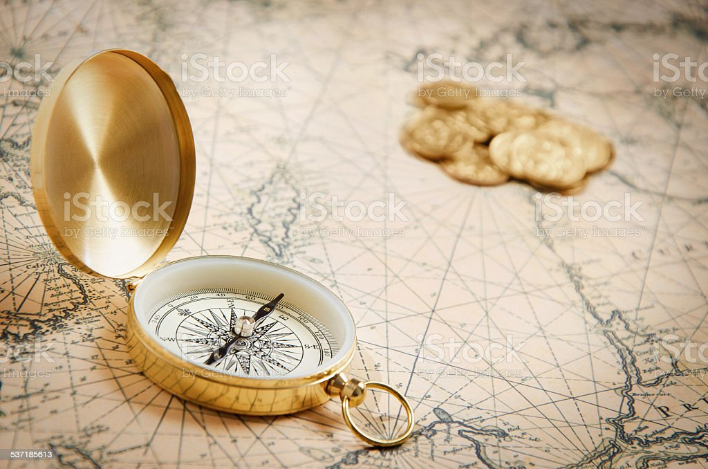 Compass on the old map stock photo