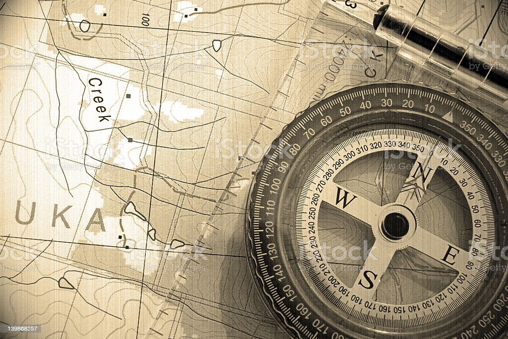 Compass on the top of map (vintage) #2 royalty-free stock photo