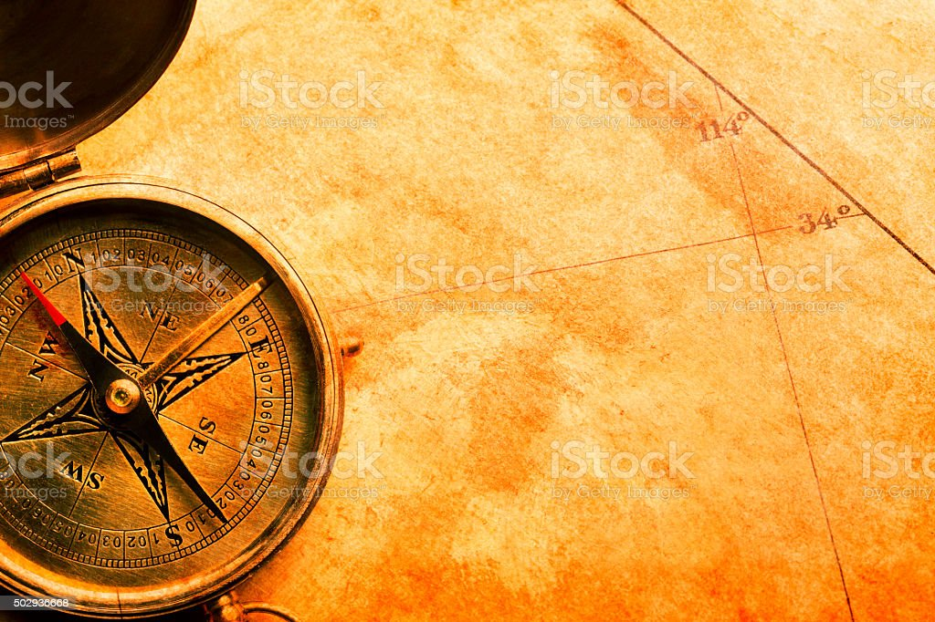 Compass On Top Of A Map stock photo