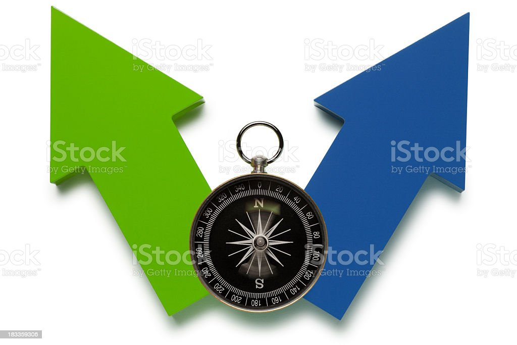 Compass On Top Of Two Arrows Pointing In Different Directions royalty-free stock photo