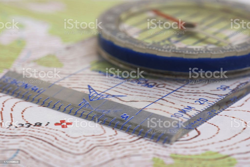 Compass on topo Close-up stock photo