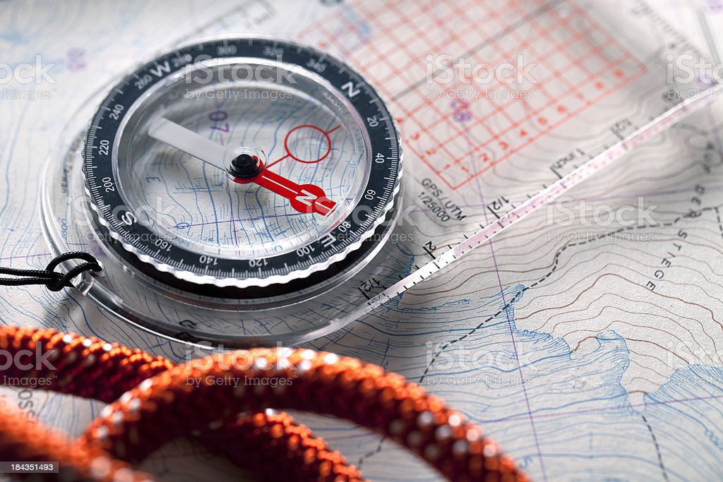 Compass on topographic maps. royalty-free stock photo