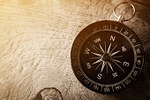 compass on wooden table in vintage style for background