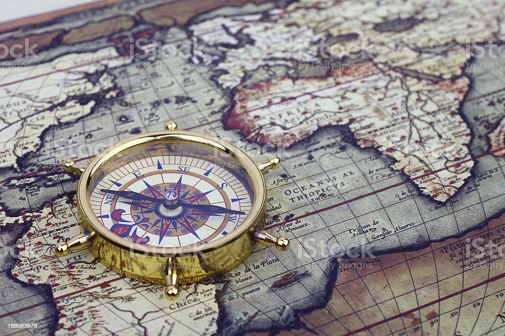 Compass on world map stock photo