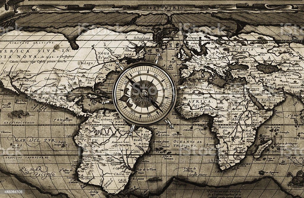 Compass on world map stock photo