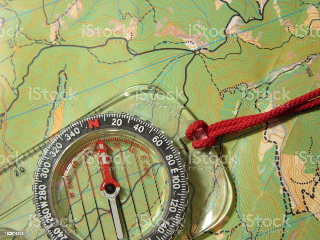 Compass over a map royalty-free stock photo