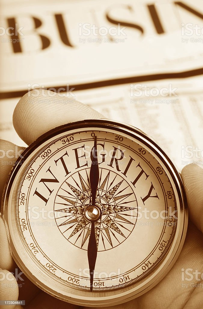 Compass Pointing the Way to Integrity in Business stock photo