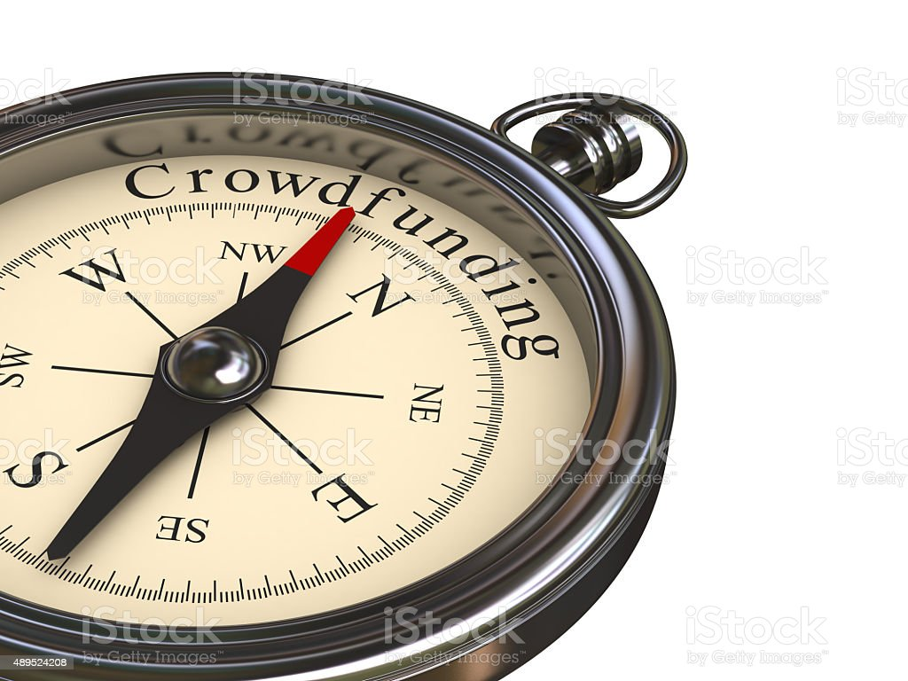 Compass Pointing to Crowdfunding stock photo