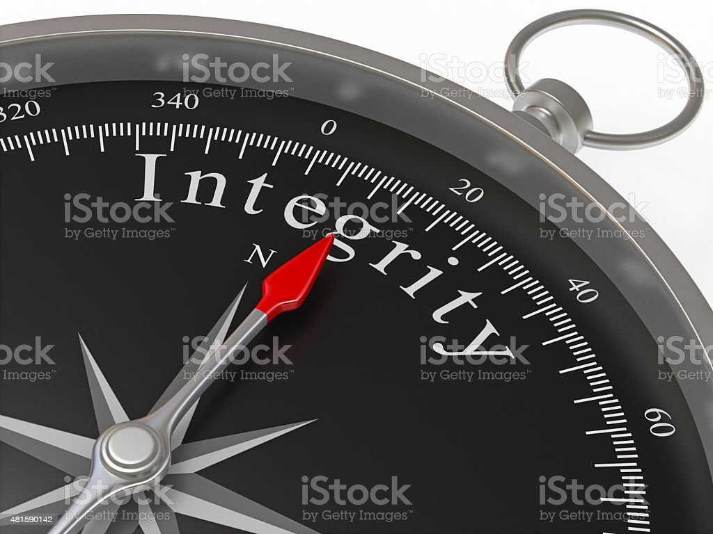 Compass Pointing to Integrity stock photo