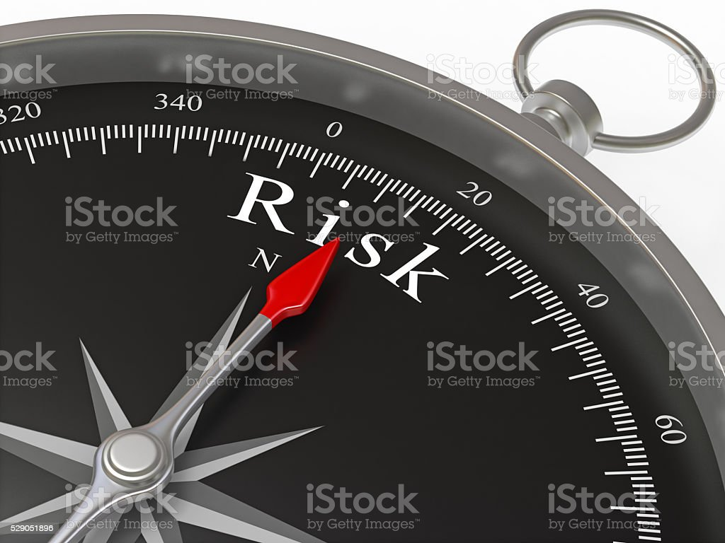 Compass Pointing to Risk stock photo