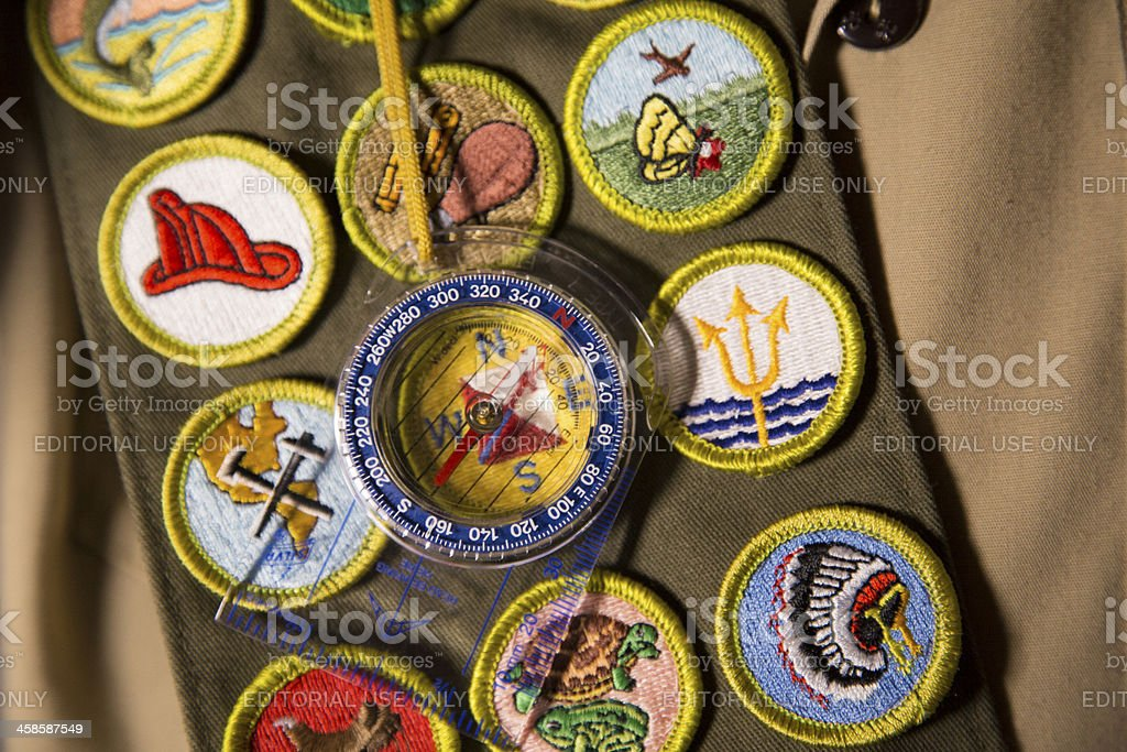 Compass sitting on scout uniform stock photo