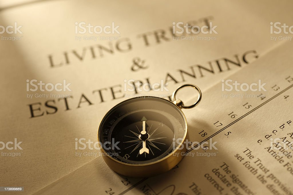 Compass Sitting On Top Of Living Trust Document royalty-free stock photo