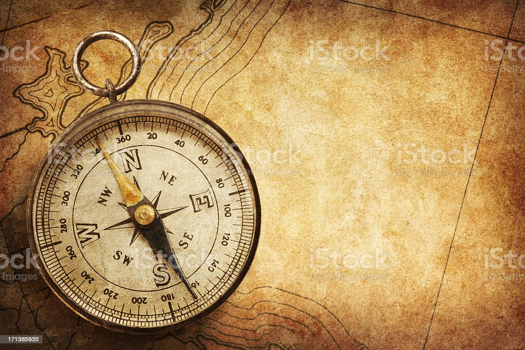 Compass sitting on top of old map stock photo