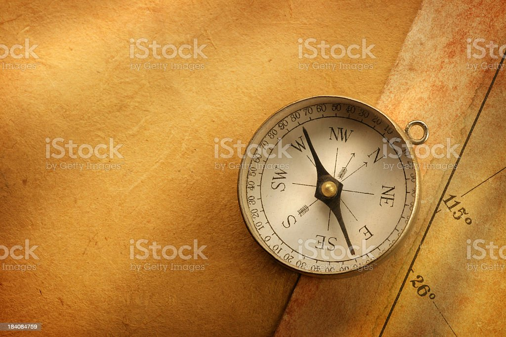 Compass Sitting On Top  Of Old Map Strong Directional Lighting royalty-free stock photo