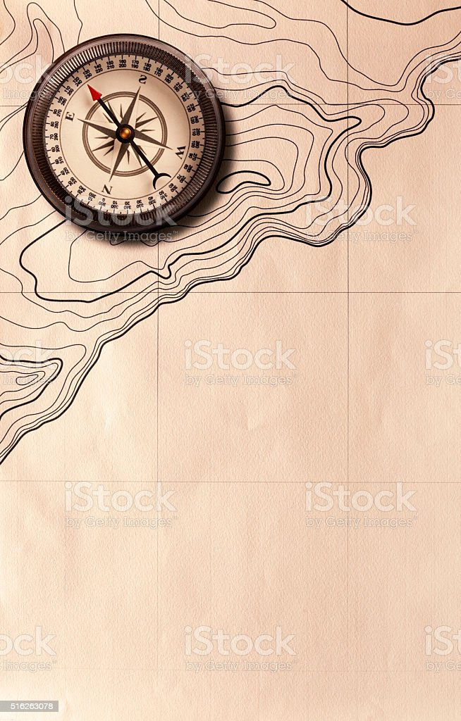 Compass stting on top of an antique map stock photo