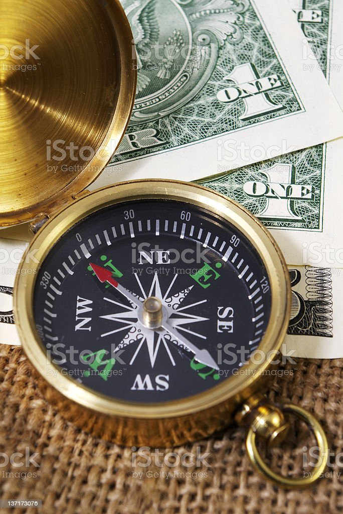 Compass with US Dollars royalty-free stock photo