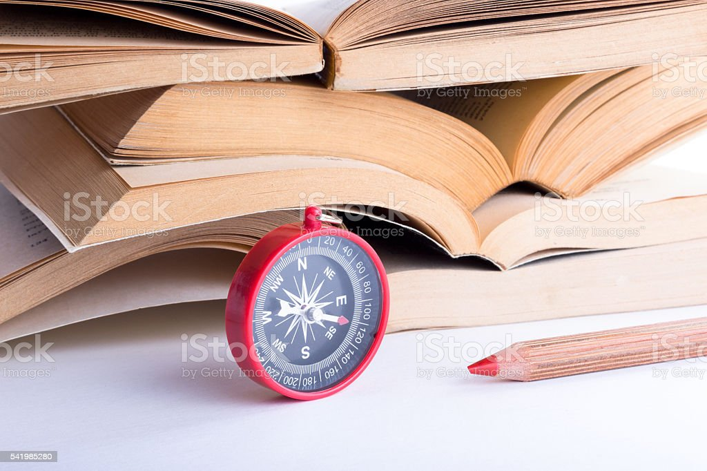 compass,books and pencil stock photo