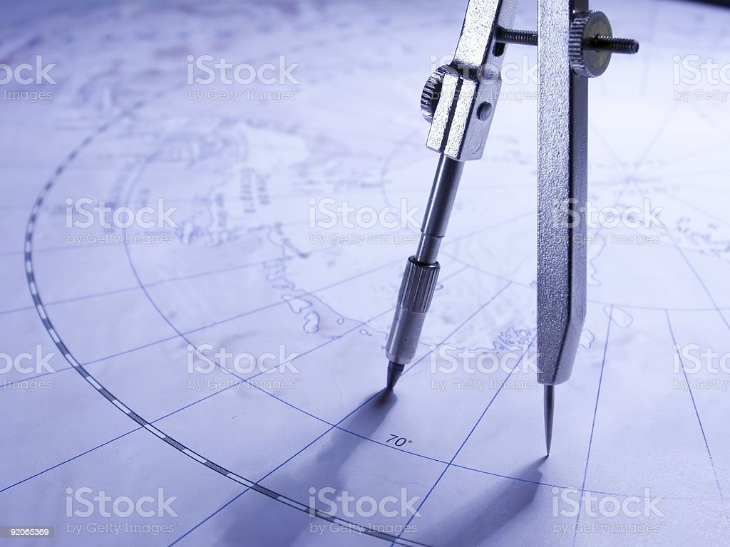 Compasses on the map stock photo