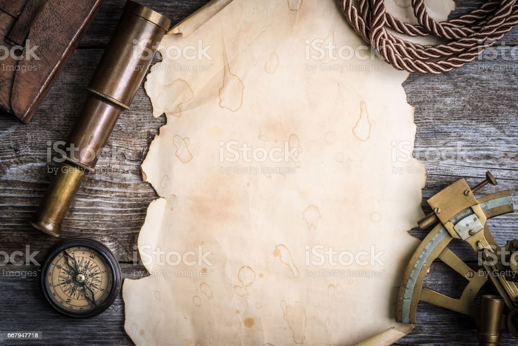 compass,sextant, spyglass and vintage paper on wooden background stock photo