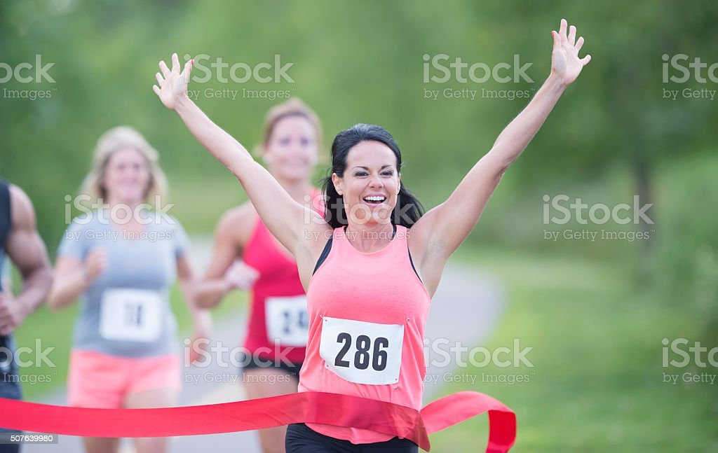 Competetive runner winning a race stock photo
