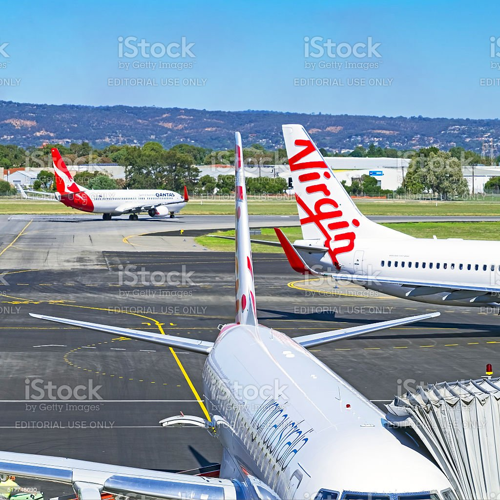 Competing airlines Qantas and Virgin at Adelaide airport stock photo