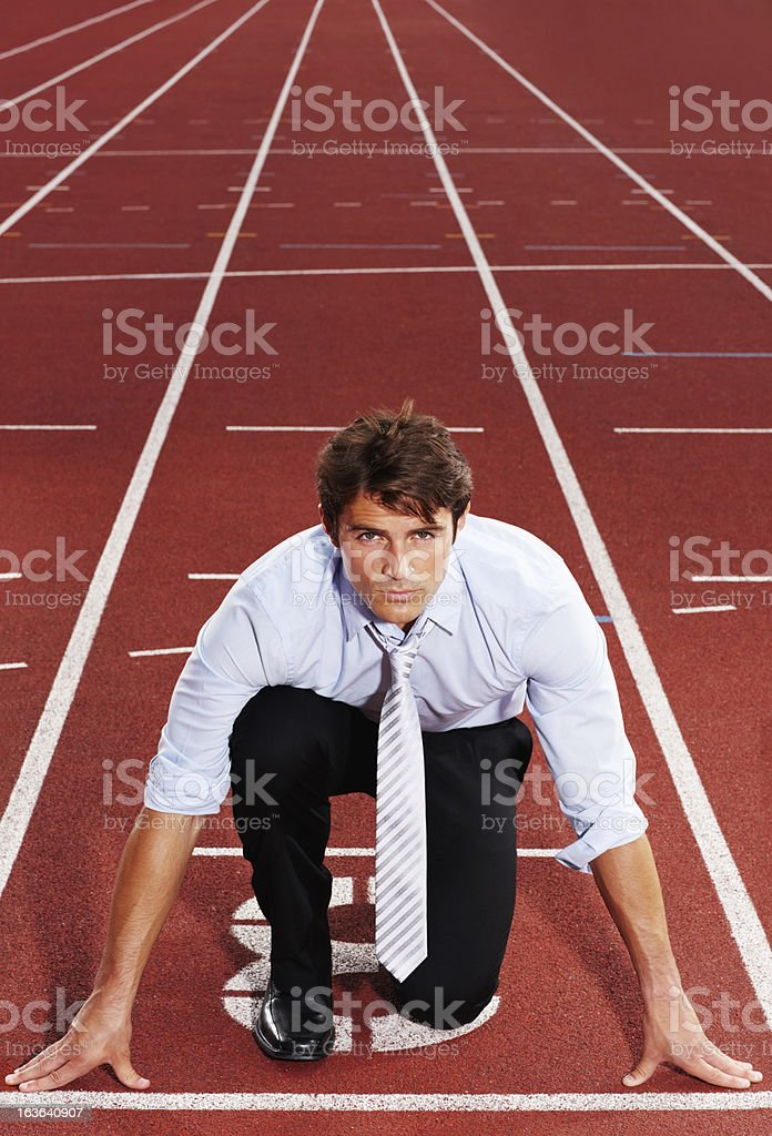 Competitive business executive is ready for race royalty-free stock photo
