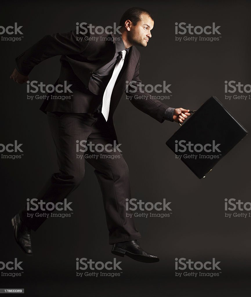 Competitive businessman jumps royalty-free stock photo
