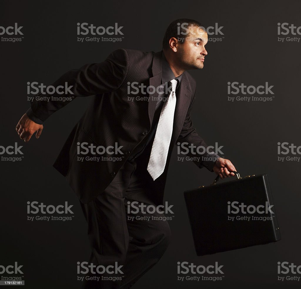 Competitive businessman running royalty-free stock photo