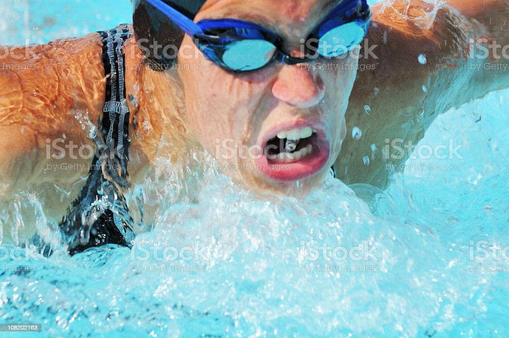 Competitive Teen Female Butterfly Swimmer Girl Power royalty-free stock photo