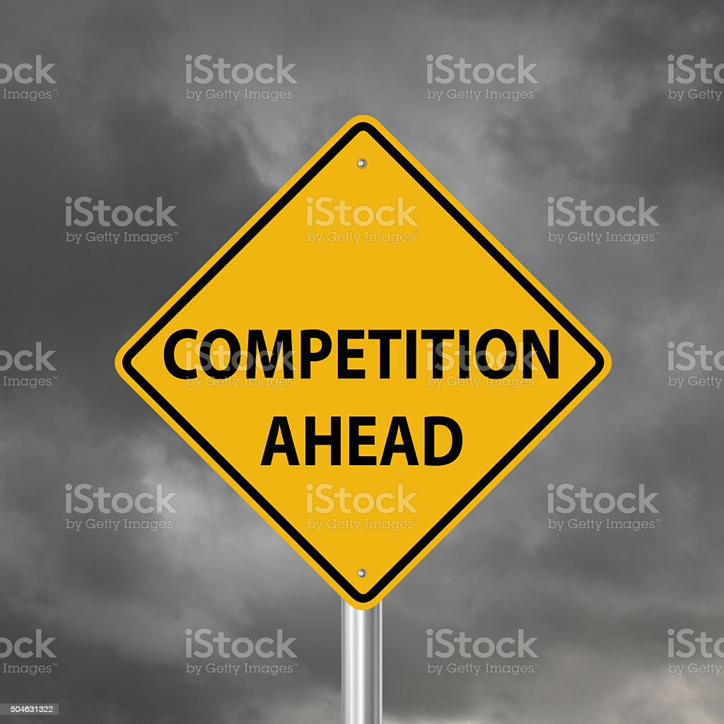 Competiton ahead warning sign stock photo