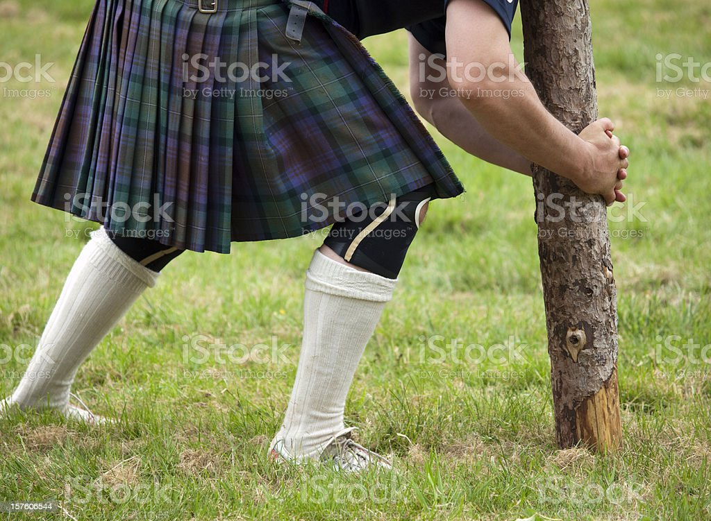 Competitor about to lift a caber royalty-free stock photo