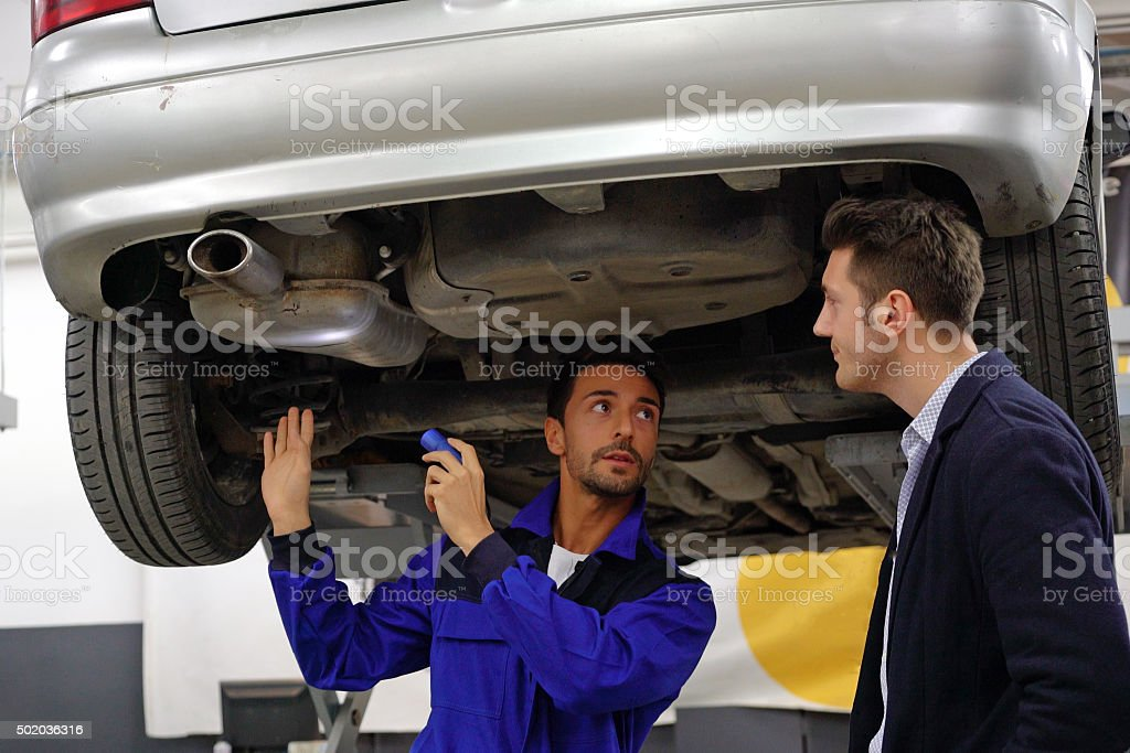 compiling a detailed vehicle assessment stock photo