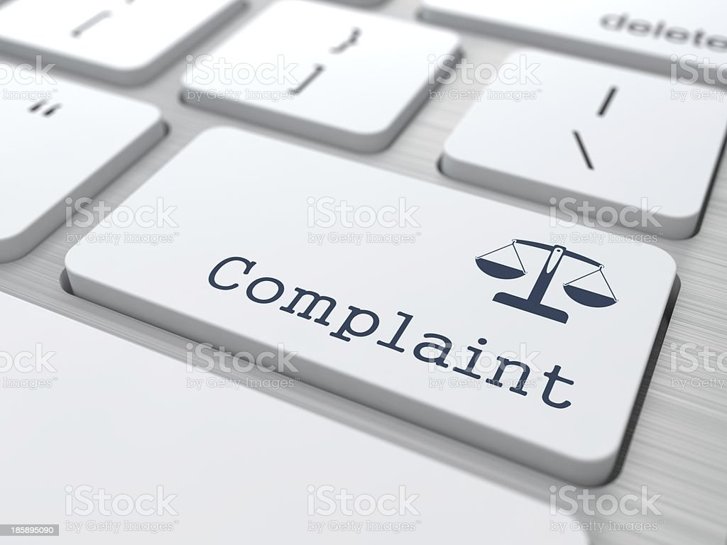 Complaint button on a white keyboard stock photo